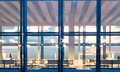 Front View Meeting Room Modern Skyscraper.Open Space Interior In Evening Time.Panoramic Windows Facade Background Royalty Free Stock Images - 69625309