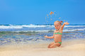 Happy Child Playing With Fun On Sand Sea Beach Stock Image - 69635621