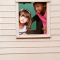 Two Girls Playing In Playhouse Stock Photography - 69651352