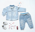 Top View Trendy Denim Look Of Baby Boy Clothes With Toy And Snea Royalty Free Stock Image - 69675926