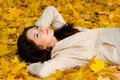 Young Women Rest On The Autumn Leaf Stock Photos - 6975073