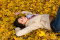Young Women Rest On The Autumn Leaf Royalty Free Stock Photography - 6975117