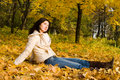 Young Women Rest On The Autumn Leaf Stock Photo - 6975250