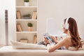 Positive Girl Sitting On The Sofa Royalty Free Stock Photo - 69700555