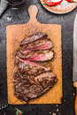 Roasted Sliced Grill Steak On Wooden Cutting Board Royalty Free Stock Photography - 69703587