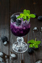 Tasty Blackberry Cocktail In Wine Glass With Mint And Ice On Dark Wooden Table. Summer Berry Lemonade Royalty Free Stock Photo - 69709945