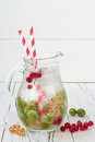 Healthy Detox Berry Infused Flavored Water. Summer Refreshing Homemade Drink With Gooseberries And White And Red Currant On White Stock Photo - 69723880
