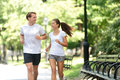 Friends Couple Happy Running Together In City Park Stock Image - 69750611