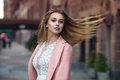 Gorgeous Girl With Long Blonde Hair Blowing In The Wind In City Street Royalty Free Stock Image - 69756456