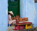An Old Woman Selling Souvenirs On Street In Hoi An, Vietnam Stock Photography - 69768692