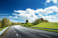 Car On Asphalt Road In Beautiful Spring Day Stock Photography - 69774622