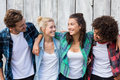 Friends Standing With Arms Around Royalty Free Stock Images - 69799919