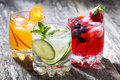 Assortment Of Fresh Iced Fruit Drinks On Wooden Background Stock Photo - 69826940