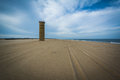 Tire Tracks On The Beach And A World War II Observation Tower At Stock Image - 69849421