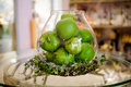 Green Apples On Table In Vase Stock Images - 69854124