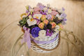 Beautiful Purple  Bouquet Of Mixed Flowers In Basket On Table Stock Photography - 69854462