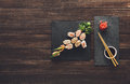 Set Of Sushi Maki And Rolls At Black Rustic Wood. Stock Image - 69856031