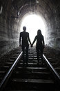 Couple Walking Together Through A Railway Tunnel Royalty Free Stock Images - 69862539
