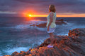 Women Standing On The Rocky Beach At Beautiful Sunrise Stock Photography - 69871032