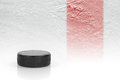Hockey Puck On The Red Line Stock Images - 69874374