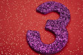 Number Three Purple Color Over A Red Background. Anniversary Royalty Free Stock Photos - 69877938