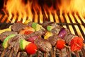 Roasted Beef Kebabs With Vegetables On BBQ Flaming Grill Royalty Free Stock Images - 69883709