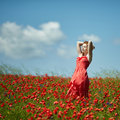 Red Haired Beautiful Girl In Poppy Field Royalty Free Stock Photo - 69885375