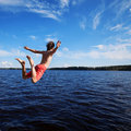 Young Man Jumping Into Water Royalty Free Stock Image - 69894616