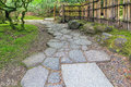 Stone Path Walkway With Bamboo Fence Royalty Free Stock Photography - 69919887
