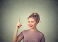 Attractive Young Woman In Casual Clothes Pointing Her Finger Up Has An Idea Stock Photography - 69938062