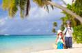 Little Boy And Girl Travel On Summer Tropical Beach Royalty Free Stock Photo - 69961325