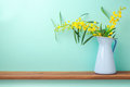 Flowers In Vase On Wooden Shelf Stock Photo - 69984900