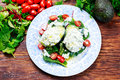 Avocado Halves Stuffed With Cottage Cheese And Vegetables Royalty Free Stock Image - 69990696