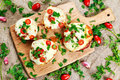 Cooked Mushrooms Stuffed With Cheese And Plum Tomatoes Stock Photography - 69991102