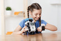 Nice Girl Playing With Robot Royalty Free Stock Photo - 70001965