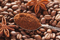 Grounded Coffee In Silver Spoon Above Coffe Beans Stock Photo - 70036990
