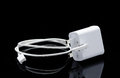 White USB Cable For Smartphone And Its Reflection Stock Photos - 70045793