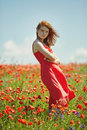 Red Haired Beautiful Girl In Poppy Field Royalty Free Stock Image - 70075836