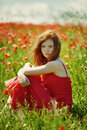 Red Haired Beautiful Girl In Poppy Field Royalty Free Stock Photo - 70076305