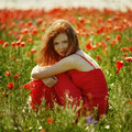 Red Haired Beautiful Girl In Poppy Field Royalty Free Stock Photo - 70076325