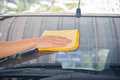 Hand Wipe Cleaning The Car Glass Royalty Free Stock Photo - 70080505