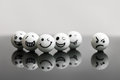 White Marbles With Faces Stock Photo - 70134360