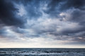 Dramatic Stormy Dark Cloudy Sky Over Sea Royalty Free Stock Image - 70134596