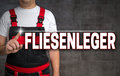 Fliesenleger (in German Tiler) Touchscreen Is Shown By Craftsman Royalty Free Stock Photography - 70137427
