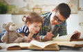 Children Brother And Sister, Boy And Girl Reading A Book Stock Photography - 70148182