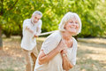 Two Seniors Playing Tug Of War Royalty Free Stock Images - 70179009
