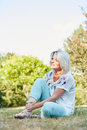 Senior Woman With Sprained Foot In Park With Pain Royalty Free Stock Photo - 70179145