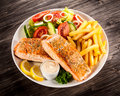 Roasted Salmon With French Fries Royalty Free Stock Photography - 70184767
