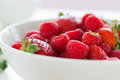 Summer Fresh Red Juicy Fruits – Raspberries And Strawberries In A White Bowl On A Table For Breakfast Or Lunch Royalty Free Stock Images - 70196589
