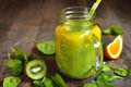 Two-coloured Smoothie From Spinach,kiwi And Orange. Stock Photos - 70212673